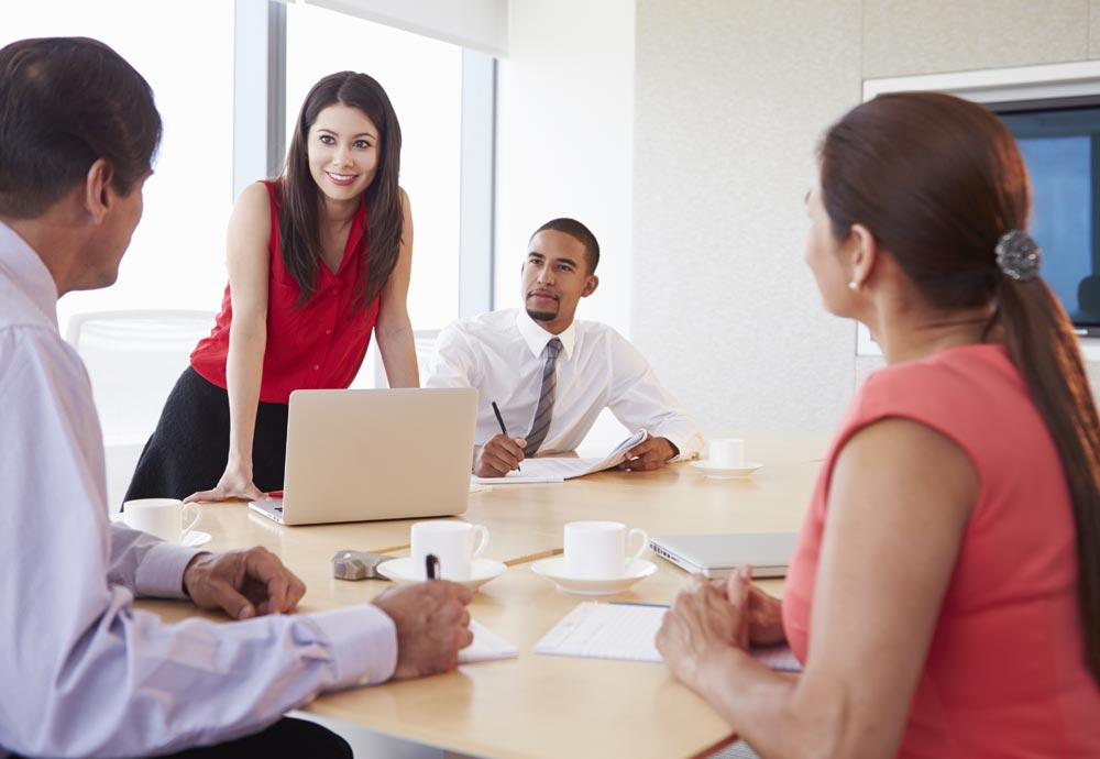 Woman presenting in boardroom meeting